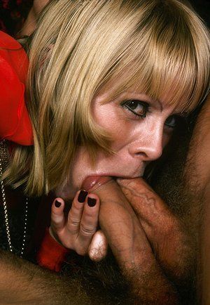 Two cocks in her mouth